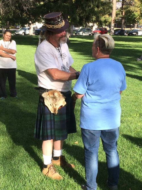 Salt Lake City 15th Annual Pagan Pride Day, Rex Juhlin (l) and Debra Hurst offering sacred oath, Saturday, September 17, 2016, Liberty Park, Salt Lake City, UT